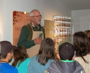 A docent speaking in front of a group