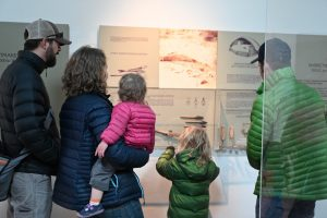A family looking at a display