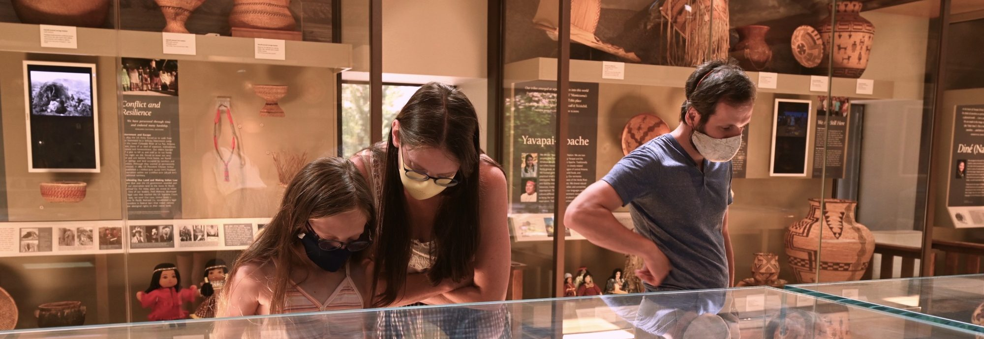 A family looking at a display case