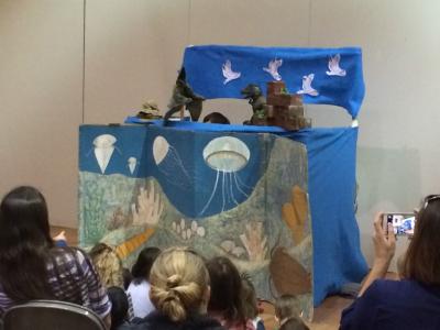 Dinosaur puppet show